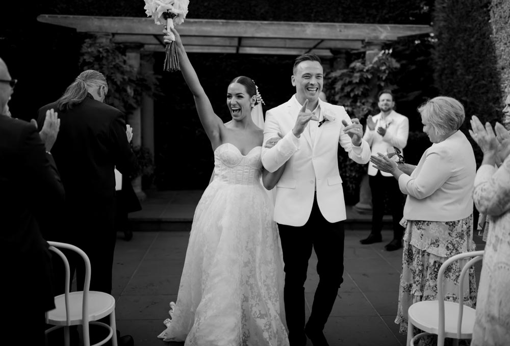black and white image of happily just married couple