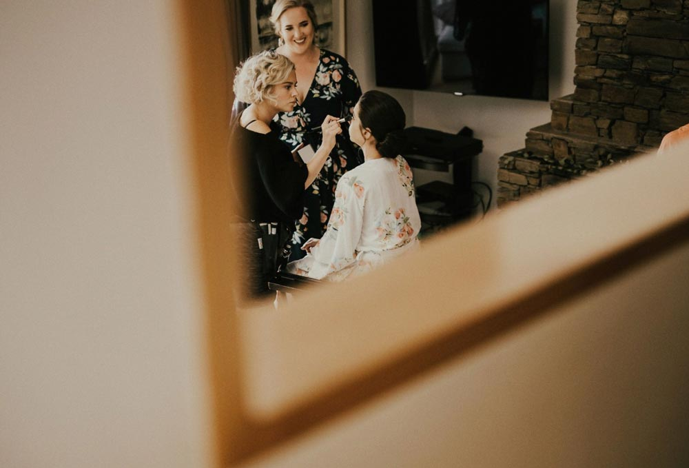 makeup artist applyig makeup on bride to be