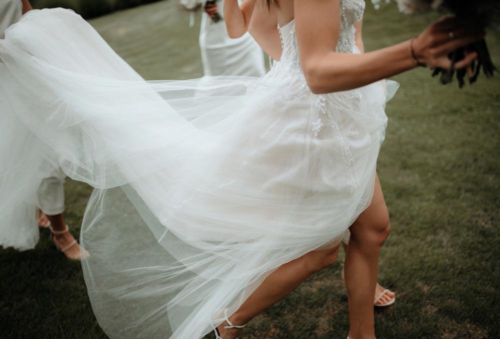 brides wedding dress flowing in wind